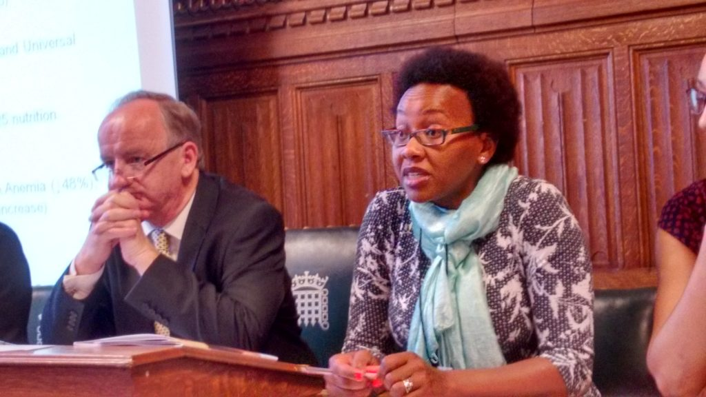 """Esther Kariuki and MP Laurence Robertson at the """"'What works for Nutrition? Stories of Success from Vietnam, Uganda, and Kenya"""" report launch."""