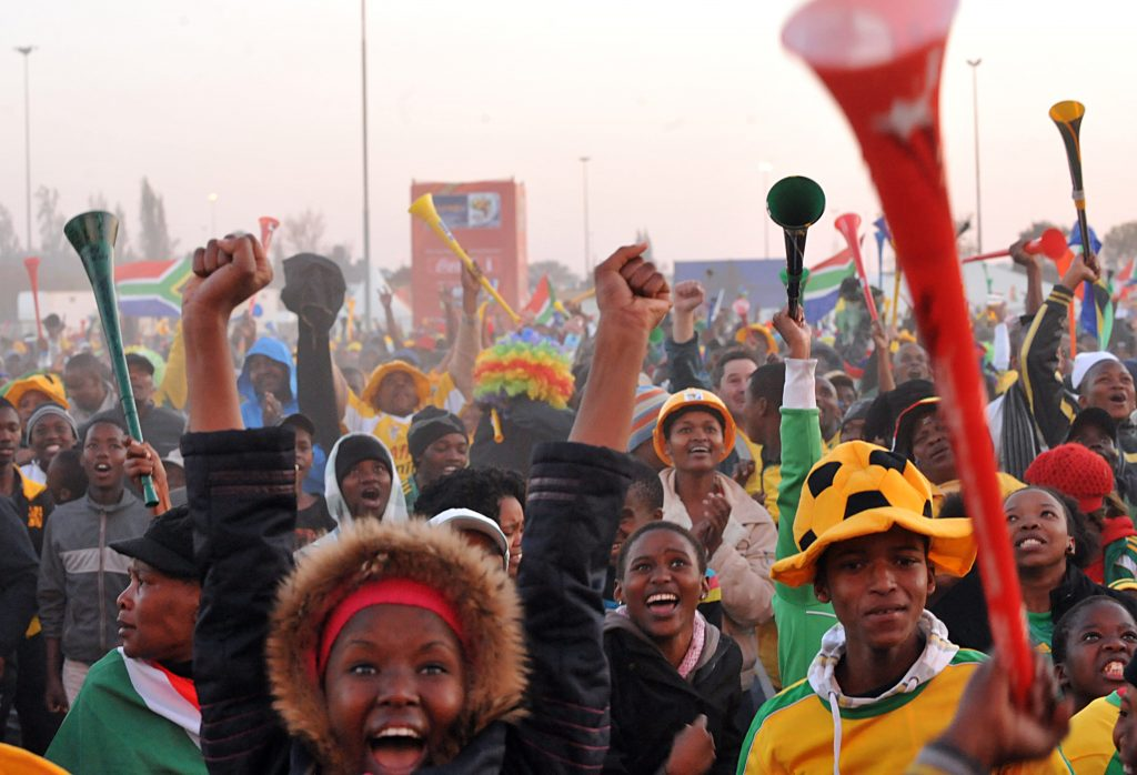 Fans of Bafana Bafana, as the South African soccer team is popularly known, watching the opening game of the World Cup on a big screen set up by FIFA in Soweto. (Photo credit: Marcello Casal Jr/Wikimedia Commons)