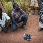 At the market in Yida, South Sudan, Kir Buth, 15, and Dictor Arak, 15, try to sell the mudfish they caught in a nearby swamp. Dictor was displaced from his home in Bentiu when fighting broke out between government and opposition troops in December 2013. He fled north to Yida with his family.