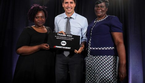 Prime Minister Justin Trudeau (center) with #GirlsEverywhere activists Patricia Ochieng (right) and Consolata Opiyo (left). (Photo credit: Dave Chan)