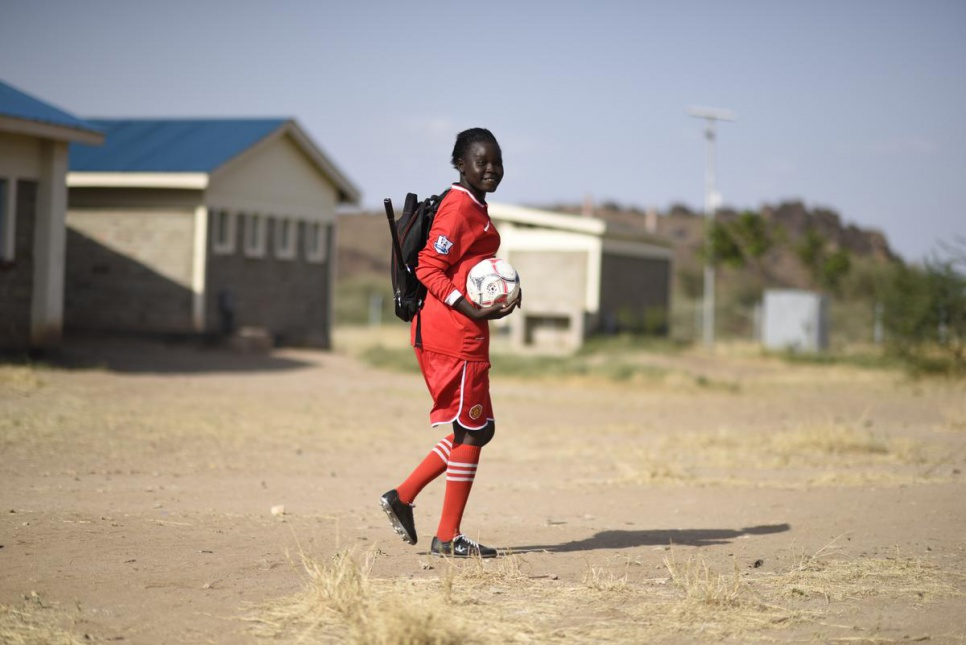 """""""I like football because it helps me to relax. It is a very popular sport in the camp,"""" Esther says. © UNHCR/Benjamin Loyseau"""