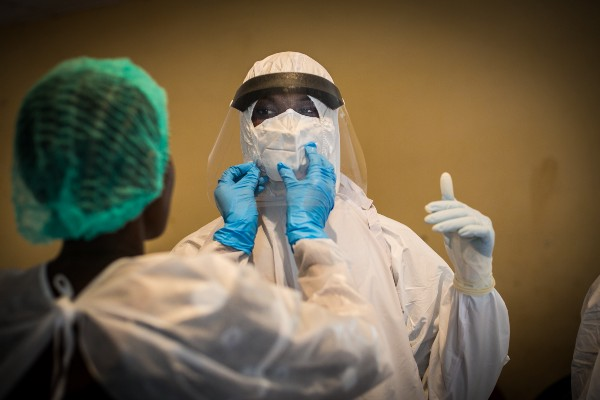 Health workers in Guinea take protective measures against Ebola.
