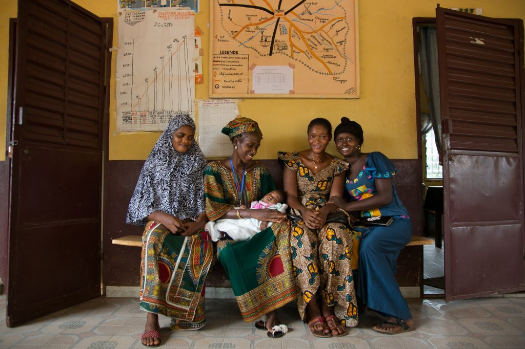 Women wait at a health center in Faranah, Guinea.