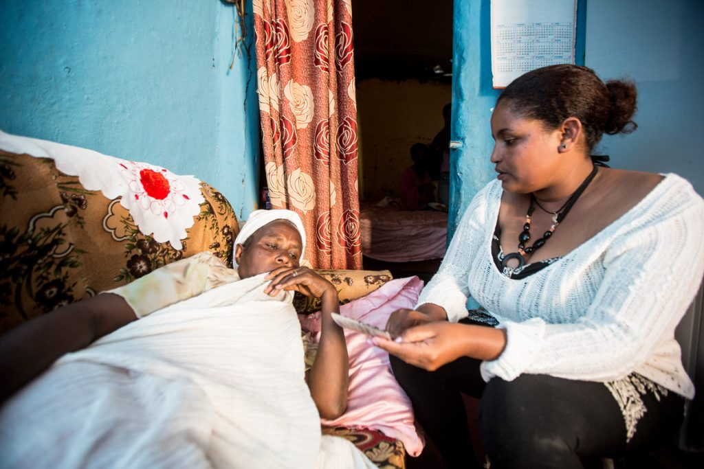 Sister Eden visits 50-year-old tuberculosis patient Desta in her home in Addis Ababa, Ethiopia. (Photo credit: John Rae/ONE)