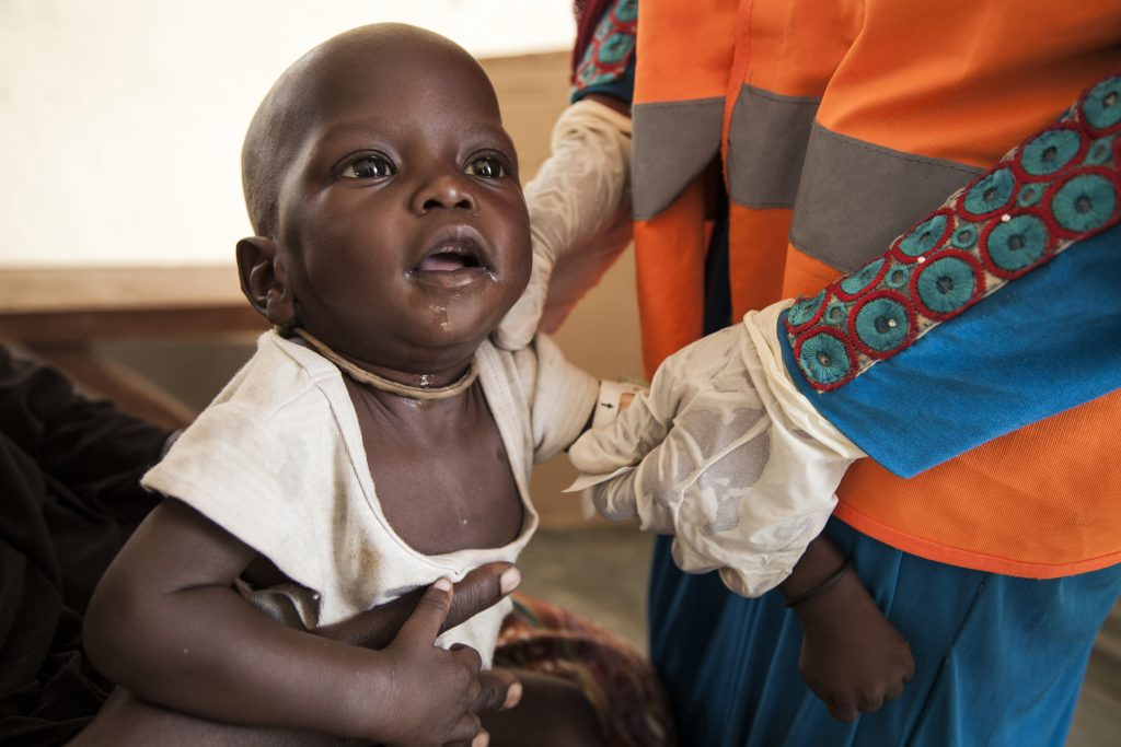 Umara is assessed for malnutrition by a UNICEF Nutrition Officer at a UNICEF supported health clinic in northeast Nigeria. (Photo credit: UNICEF)
