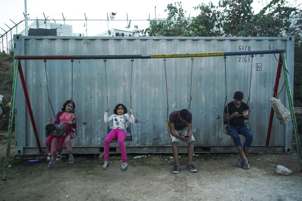 Underaged_refugees_pictured_on_a_swing_s