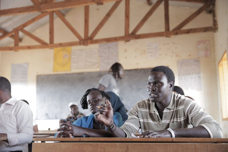 Men inside a classroom at Dadaab refugee camp in Kenya. (Photo credit: ONE)