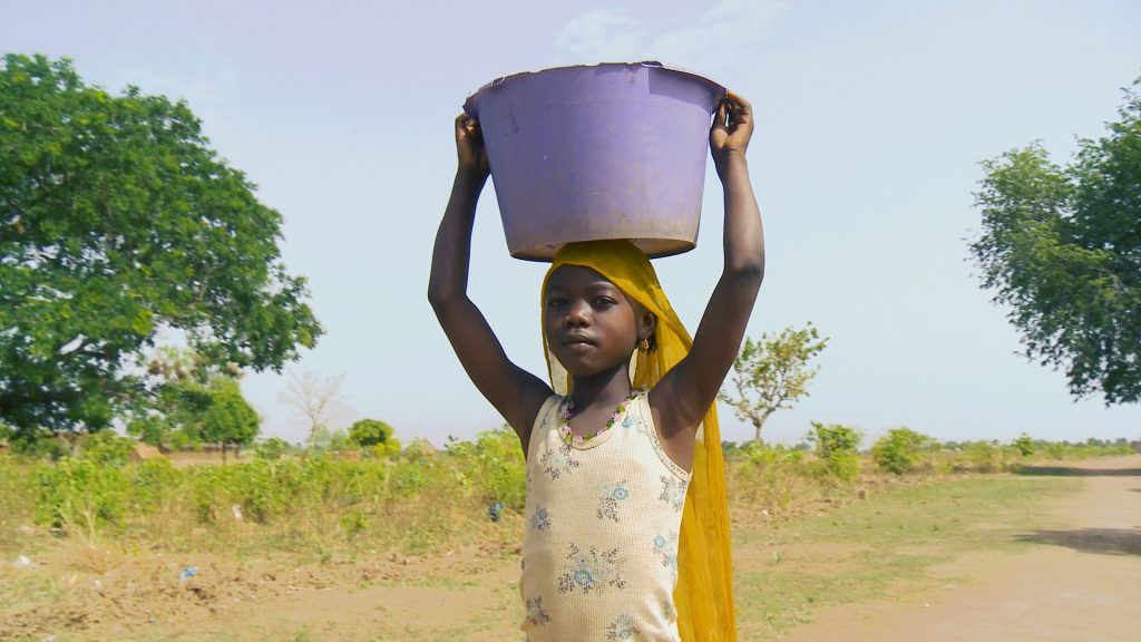 This young girl spends much of her day fetching water for her family. Many times, the responsibility of maintaining the family's water supply falls on daughters.