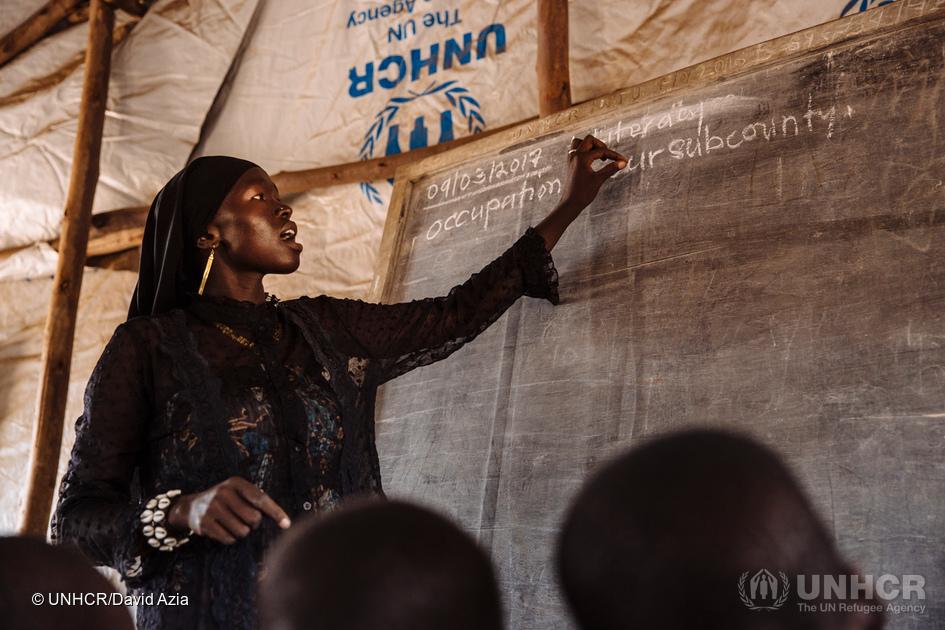 Teacher Bako Zulaika teaches a class at the Ofonze Primary School in Bidibidi refugee settlement, Yumbe District, Northern Region, Uganda. (Photo credit: David Azia/UNHCR)