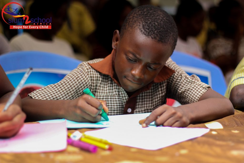 A Mokoko student draws in a classroom.