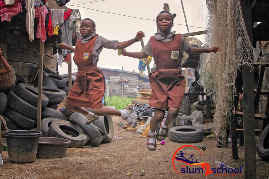 Slum2School students play in their community.