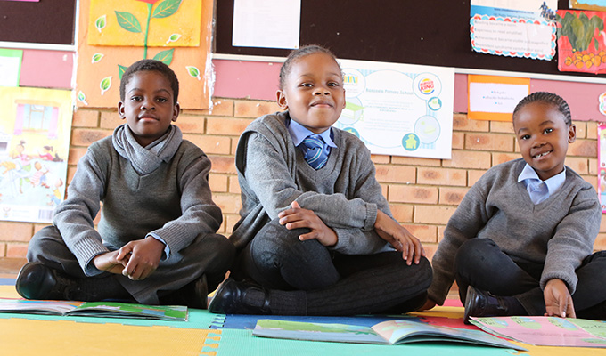 Ayanda and other students in the Baxoxele Primary School's reading program. (Photo credit: Room to Read)