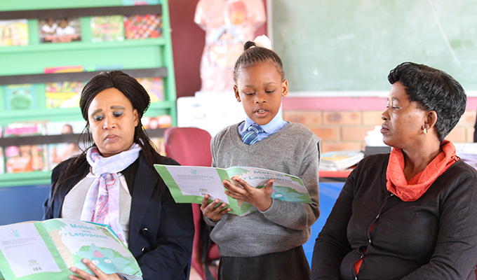Ayanda, 8, a student at Baxoxele Primary School. (Photo credit: Room to Read)