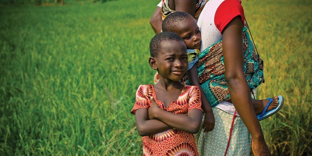 A family at the Okyereko Rice Cooperative Association in Ghana. (Photo credit: Morgana Wingard/ONE)