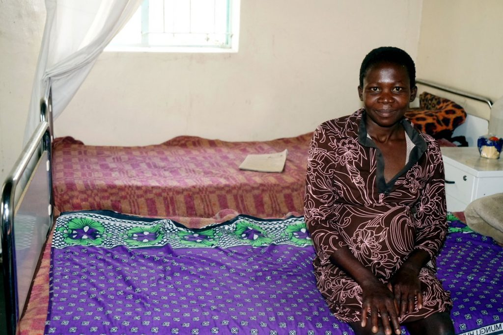An expectant mother sits at the maternity waiting home in Mashonaland province.