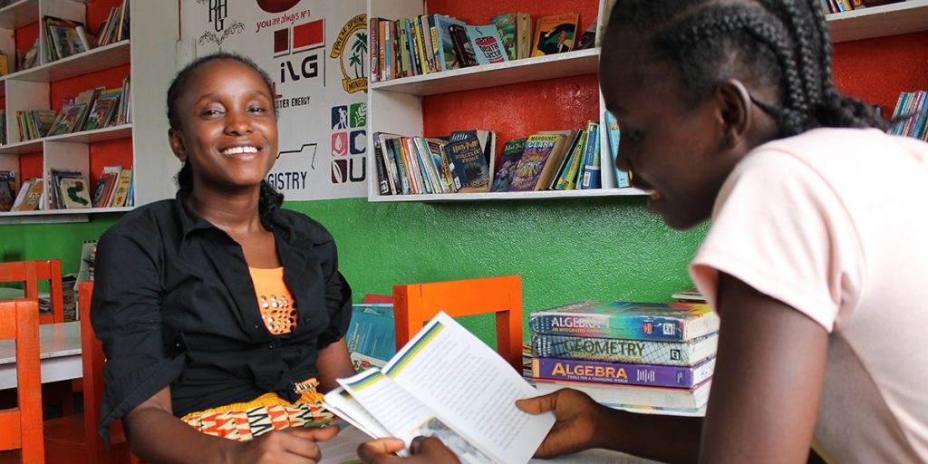 Charlotte, left, is a KEEP instructor working to help Kleada in the classroom.