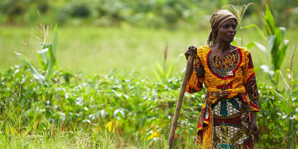 A farmer stands in her sweet potato field outside Mwasonge, Tanzania. (Photo credit: ONE)