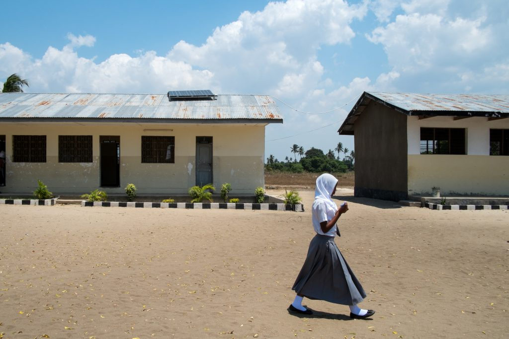 A girl on her way to class at Kingani Secondary School in Bagamoyo, Tanzania. (Photo credit: Daniel Hayduk)