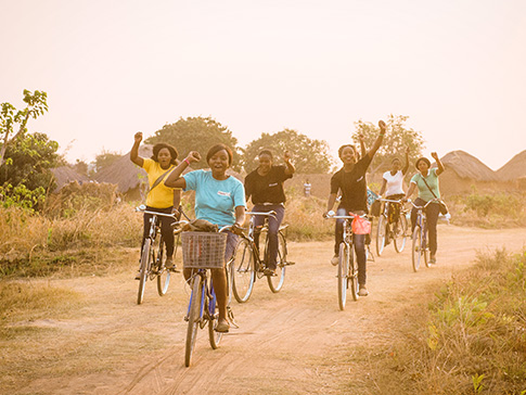 With her CAMA sisters, Alice travels to remote parts of her district, acting as GirlGuardians. (Eliza Powell/Camfed)