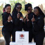 Strong Girls packing meals for Mandela Day. Arielle T (Gabon); Selmor Mtukudzi (Zimbabwe); Waje (Nigeria); Judith Sephuma (SA)