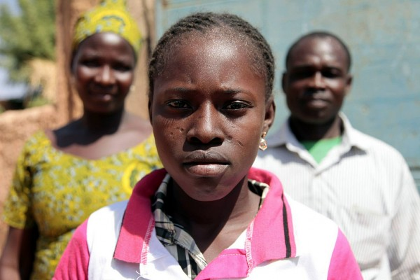 Fatmata, 13, from Burkino Faso and her parents who decided to abandon the practice of FGM/C. Credit: Jess Lea/DFID