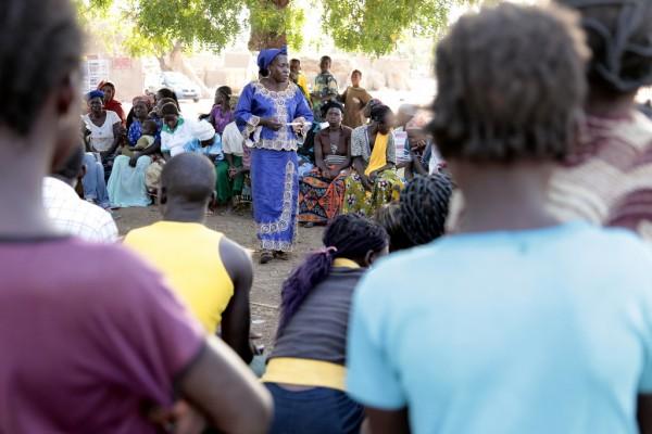 Peer educator, Rihanata Ouedraogo, leads a group discussion on FGM/C in Koassinga village, Burkina Faso. Credit: Jess Lea/DFID