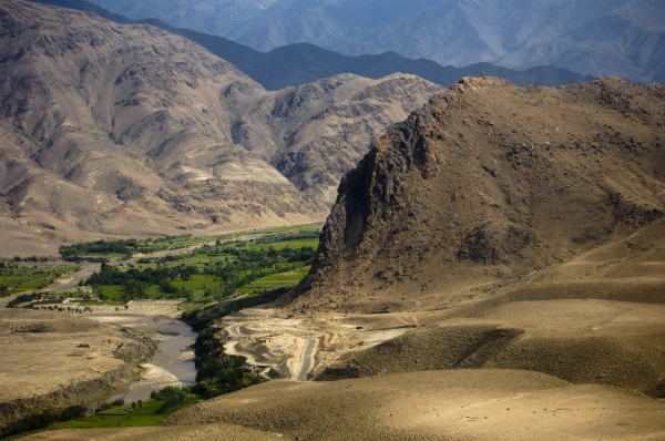 Lush greenery stands in stark contrast to the surrounding desert in Laghman Province, Afghanistan. Copyright Staff Sgt. Samuel Morse