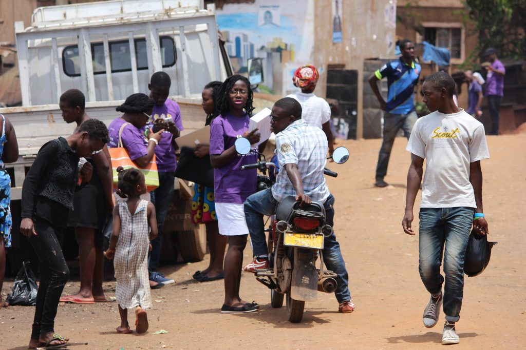 Robinah Distributing condoms to people in Kikubamutwe in Kampala, Uganda.