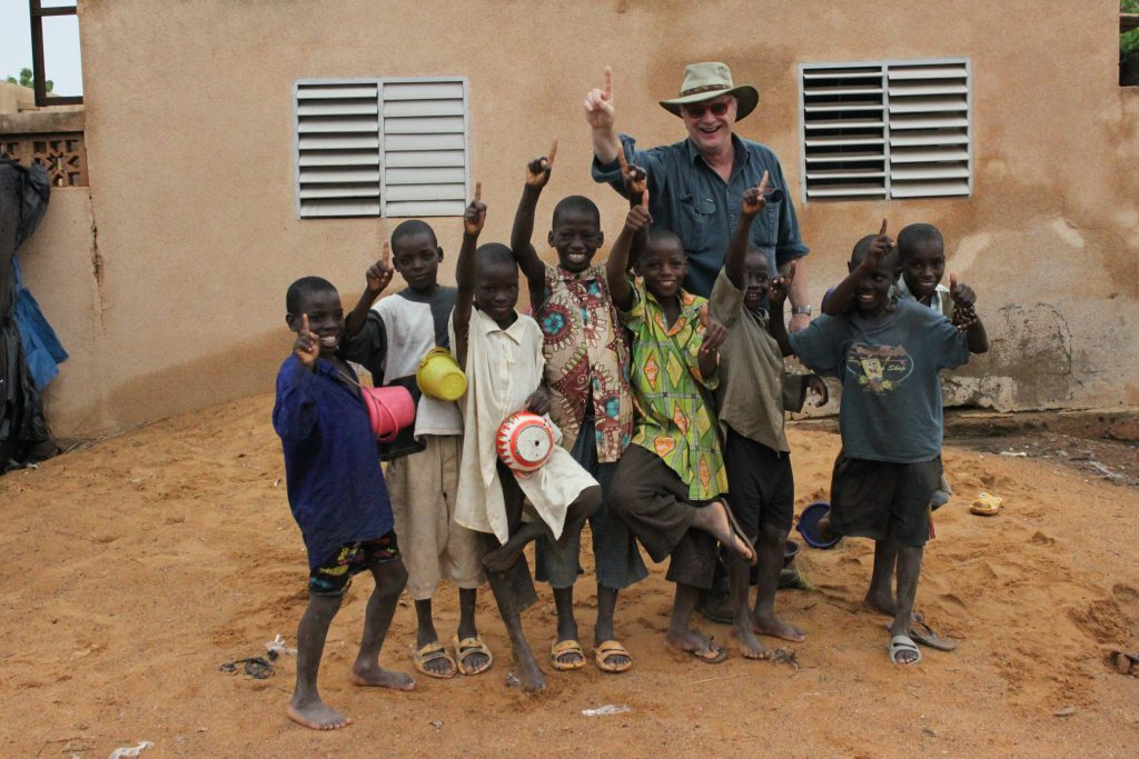 Michael Elliott with a group of children during a trip to Segou, Mali.
