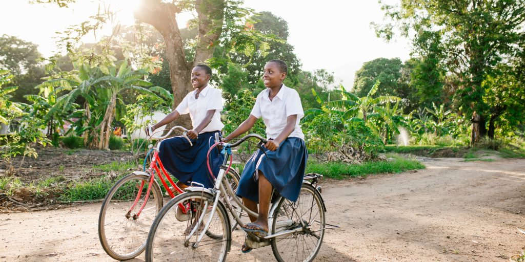 Students ride bikes to Nyange Secondary School, Kilombero Region, Tanzania. (Photo credit: Sam Vox/ONE)