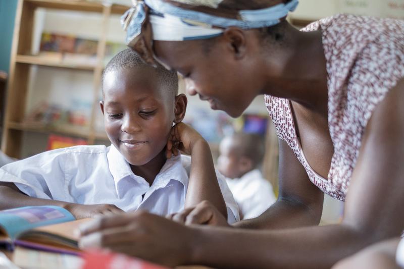 Manyinga-primary-teacher-with-pupil-smil