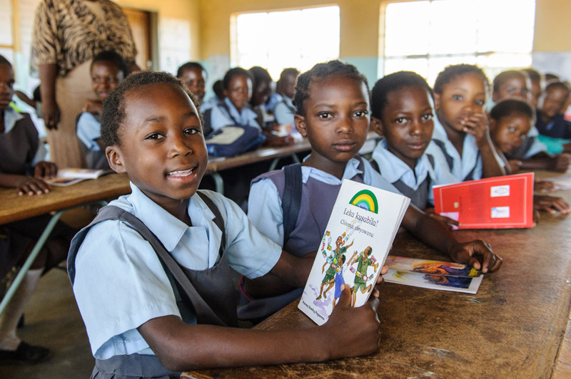 Choma-Primary-pupil-happily-holding-book