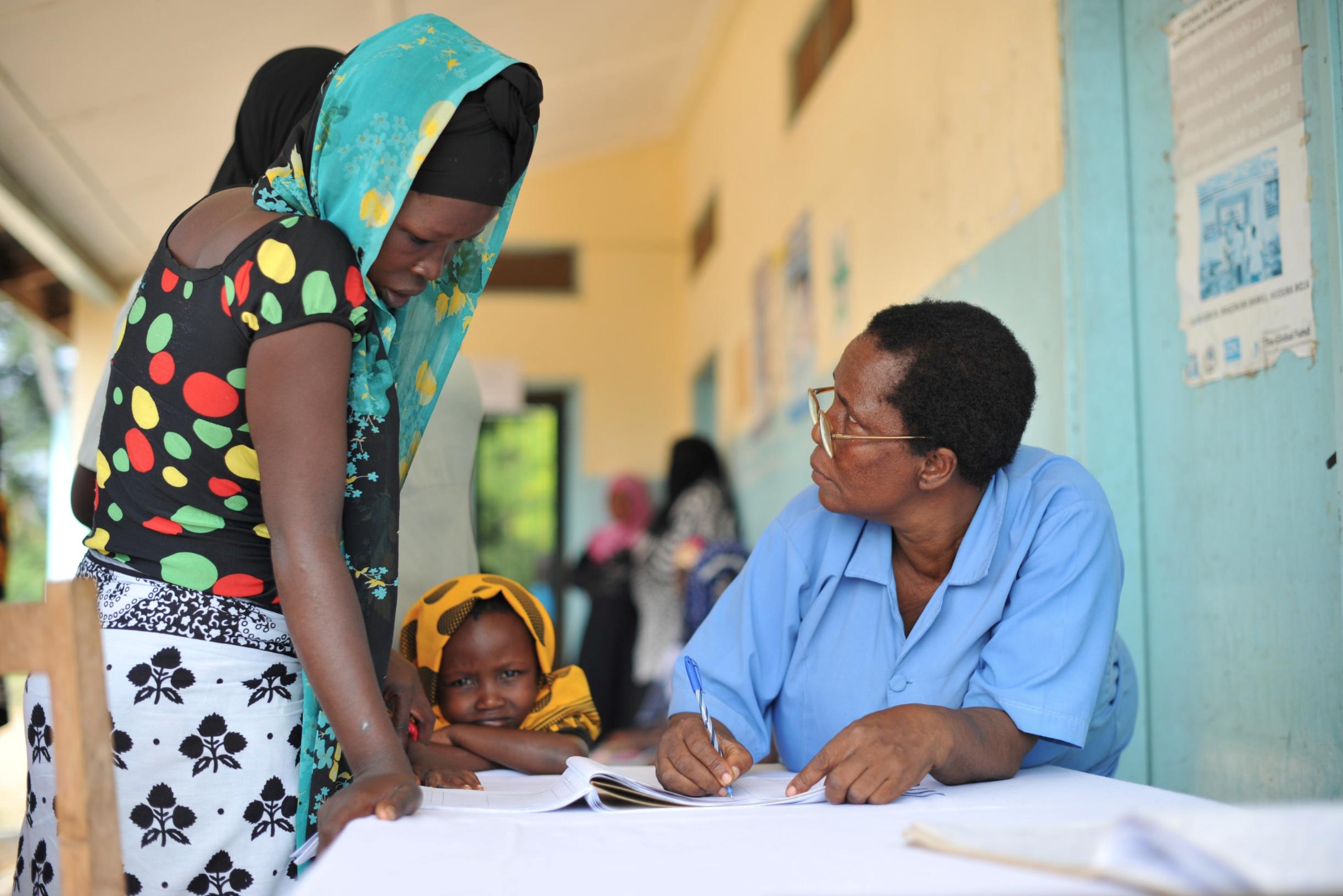 Health Officer gathers information from a Tanzanian woman at Duga Maforoni, Tanzania.