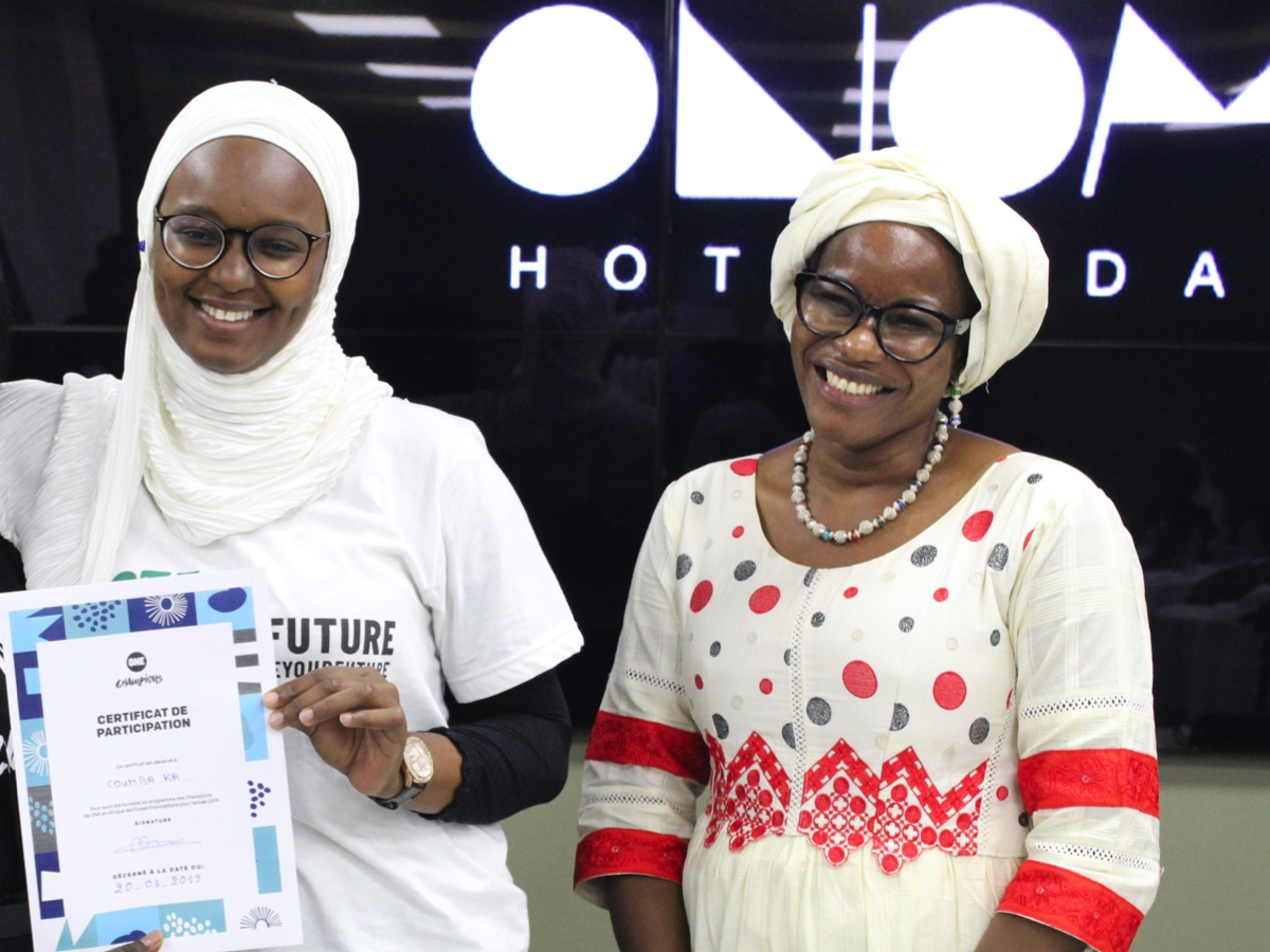 Coumba Ka (left) collects her ONE Champion certificate from Oulie Keita, ONE Director Francophone West Africa (right).