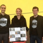 Sophie Auconie, French MEP from the Centre Right party, receiving a sample of postcards by French ONE members