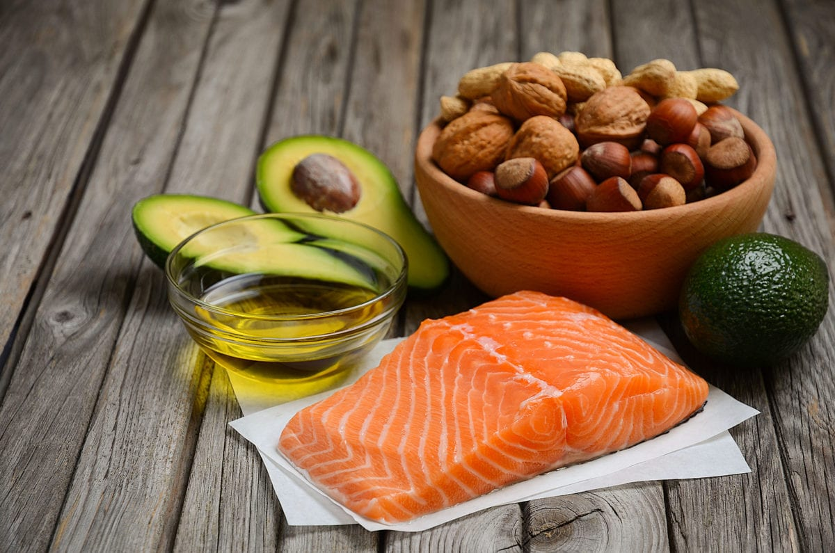 Collection of healthy fats on wooden background