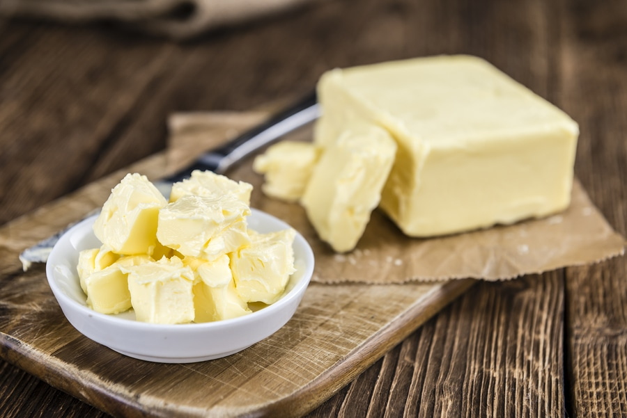butter cubes on wooden background