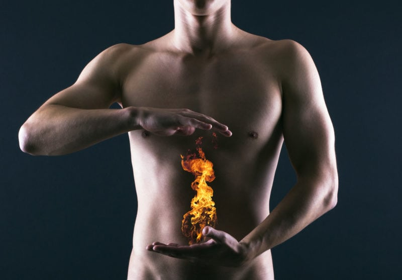 man with a flame over belly symbolizing inflammation