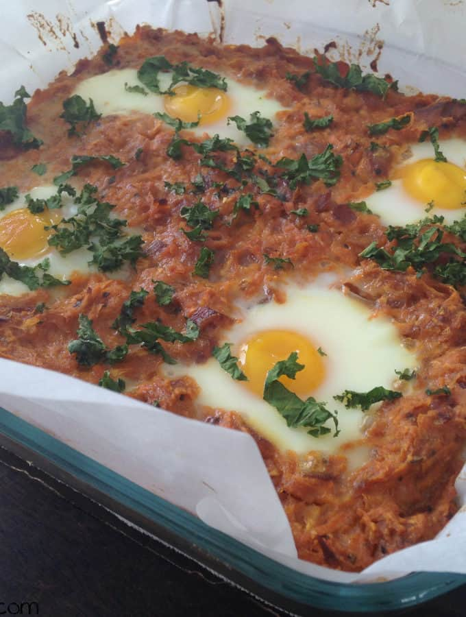 Sweet Potato And Caramelized Onion Hash With Baked Eggs On Top
