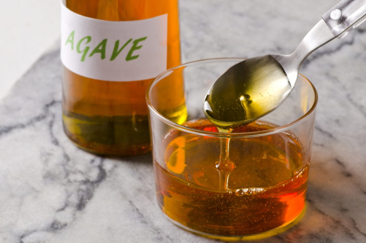 Agave Syrup Pouring On A Glass.