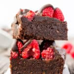 These healthy Raspberry and Chocolate Protein Brownies are deliciously moist and extra rich. Naturally sweetened, this melt in your mouth protein snack is the perfect post-workout treat. Made with dates and almond flour, this guilt-free, decadent dessert is also paleo, vegan, gluten-free, dairy-free, egg-free and flourless.