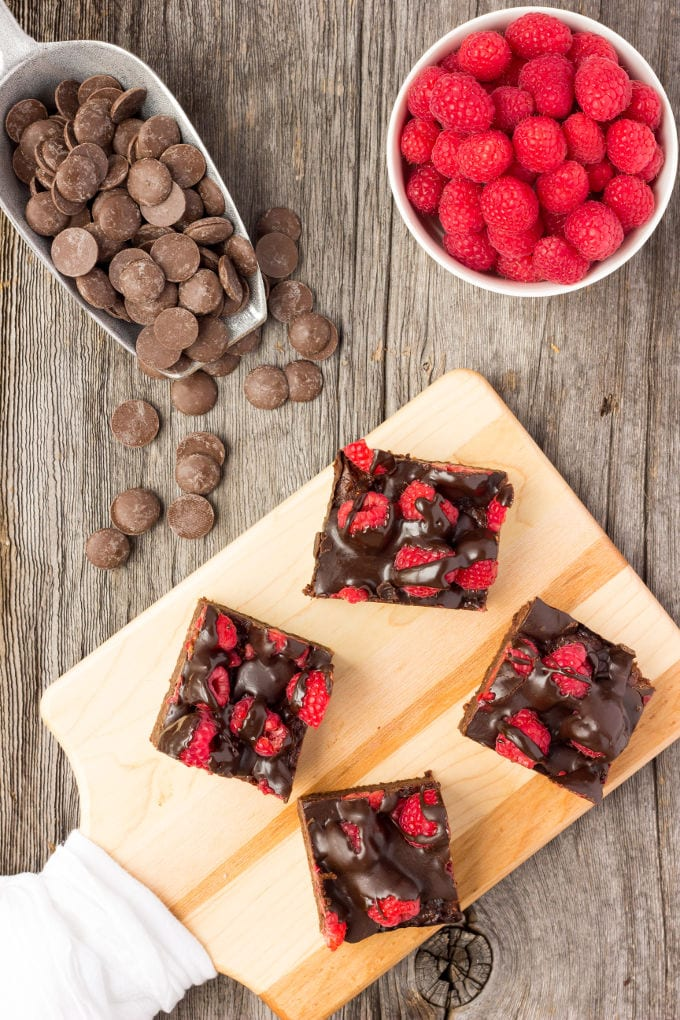 These healthy Raspberry and Chocolate Protein Brownies are deliciously moist and extra rich. Naturally sweetened, this melt in your mouth protein snack is the perfect post-workout treat. Made with dates and almond flour, this guilt-free, decadent dessert is also paleo, vegan, gluten-free, dairy-free, egg-free and flourless. | www.onecleverchef.com