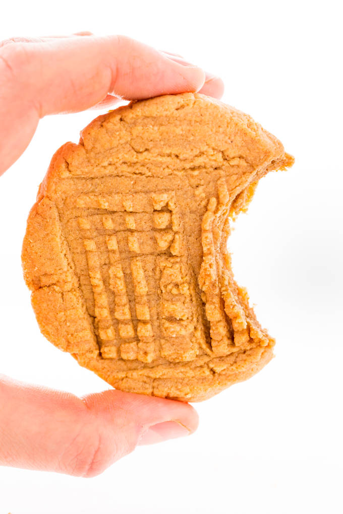 Peanut butter protein cookies held by a hand.