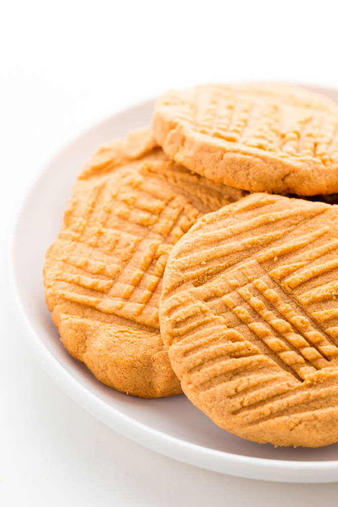 Peanut butter protein cookies on a white plate.