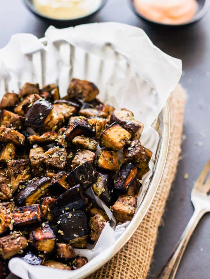 These oven roasted eggplant cubes are a delicious, much healthier alternative to potato fries. The recipe for the balsamic vinaigrette is of Mediterranean inspiration with strong Greek flavors. While being 100% healthy, this recipe is also entirely paleo, gluten-free, vegan, low-carb, dairy-free, flourless, nut-free and egg-free. | www.onecleverchef.com