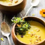 This easy and healthy curried acorn squash soup is the perfect fall comfort food. Sweet and spicy, creamy and savory, this simple potage is also vegan, gluten-free, dairy-free, paleo, vegetarian, flourless, nut-free and sugar-free. | www.onecleverchef.com