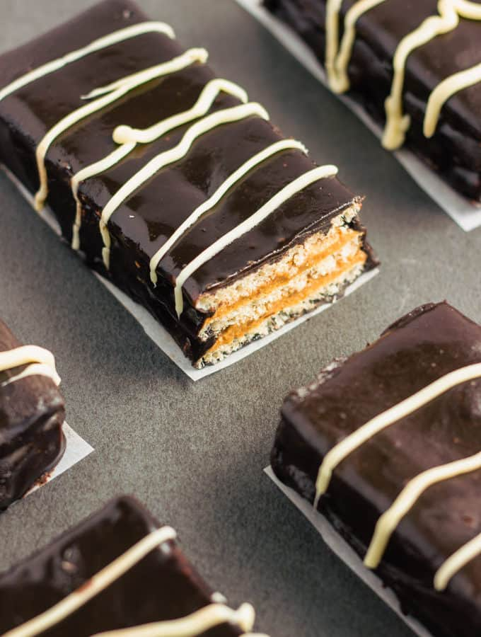 These healthy & homemade kit kat protein bars are easy to make and require only 4 simple ingredients. These extra crunchy, no-bake protein treats are the perfect post-workout snack. They are entirely gluten-free, vegan, dairy-free, egg-free, flourless and nut-free. | www.onecleverchef.com