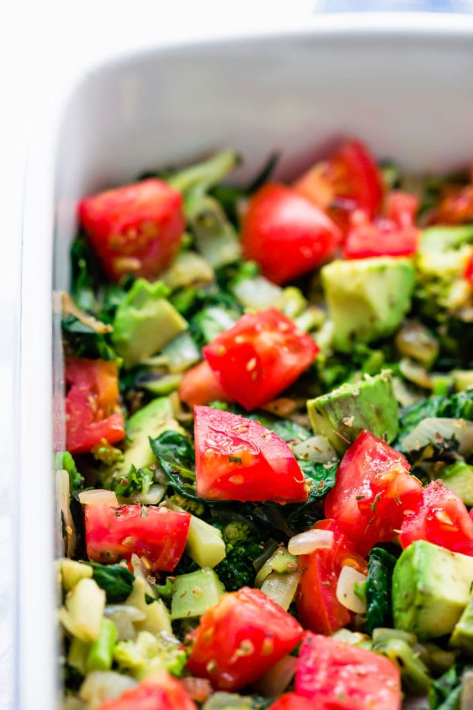 This whole30 breakfast casserole recipe is made with nothing but eggs and nutritious veggies like spinach, eggplant, avocado, broccoli and tomato. This healthy breakfast bake is the perfect easy dish for a family brunch. It is also vegetarian, paleo, low-carb, dairy-free and gluten-free. | onecleverchef.com #glutenfree #vegetarian #breakfast #cleaneating #whole30 #lowcarb #onecleverchef