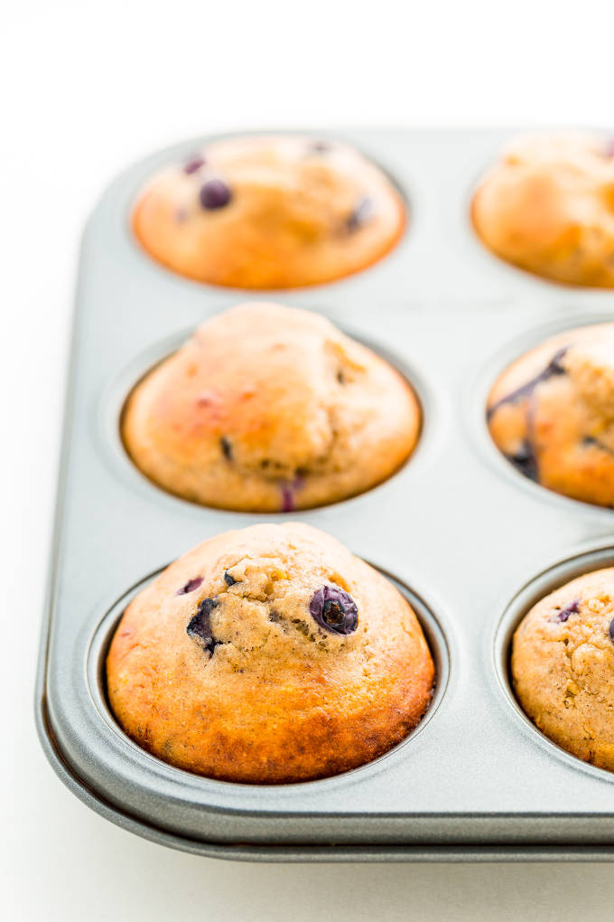 Lemon Blueberry protein muffins in a muffin tray.