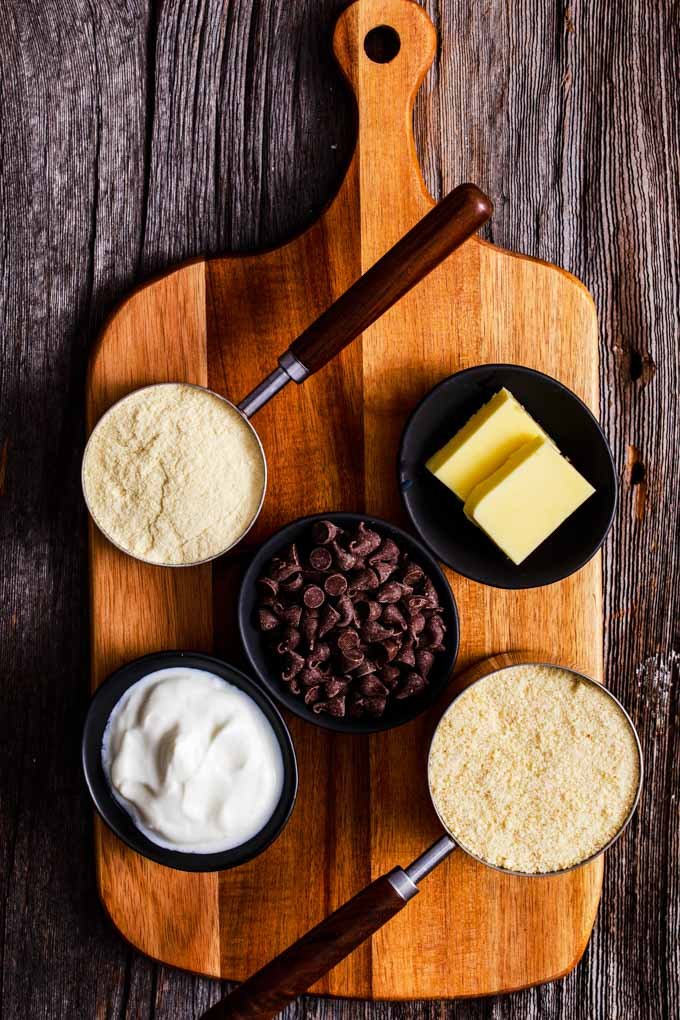 Ingredients for edible cookie dough on a wooden board.